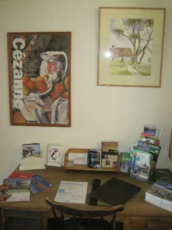 The Cottages: Desk with holiday info