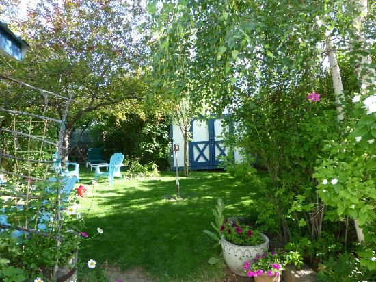 "The Painted Hills Vacation Rentals: The Hollyhock Guest House""s magical garden"