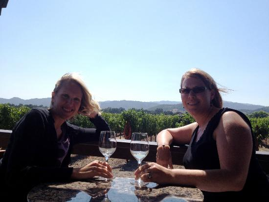 Goosecross Cellars: My best friend and I sitting on the deck of Goosecross with the vineyards behind us
