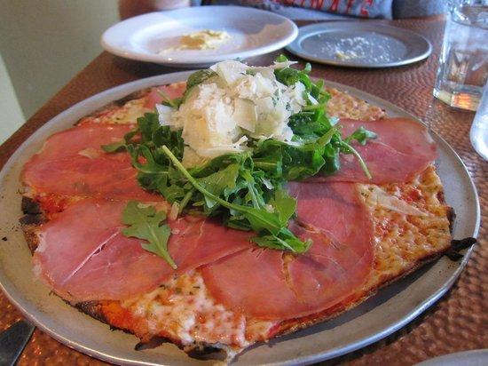 Brunelleschi's Dome Pizza: Pizza with truffle oil, porchetta, and arugula.
