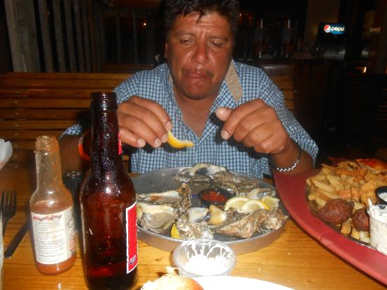 Joe's Crab Shack: my hubby eating his oysters