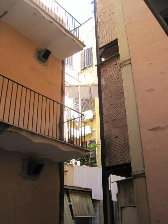 Hotel Luce: The 'patio' and the neighbouring house