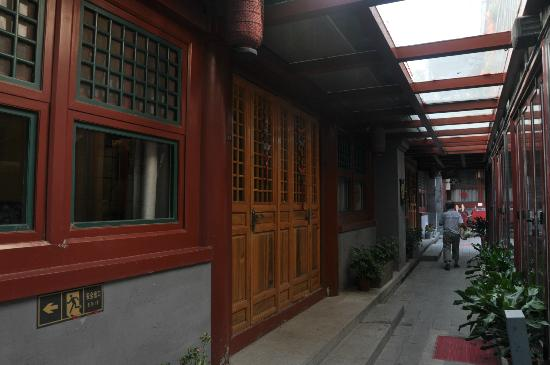 Happy Dragon Courtyard Hostel: Our private room just located at the walkway corridor, opposite is the restaurant / cafe