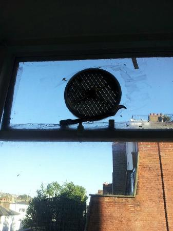 Palace Court Studios: Cellotaped windows with a non working fan