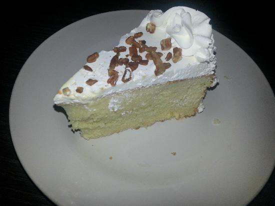 Forti's Mexican Restaurant: Tres leches cake.  Not fond of the topping.  Bottom 1/4 worth eating.  Comped.