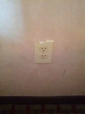 Comfort Inn:                                                       Broken electrical outlet cover