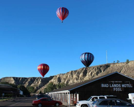Hot Air Balloons Leave Field by Badlands Motel