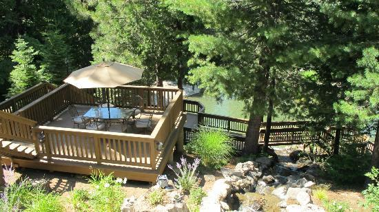 Paradise Springs: View of the swimming area, decks and waterfall