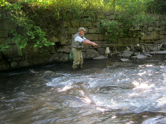Happy fishing guest with his elkhorn creek trout for West virginia fishing