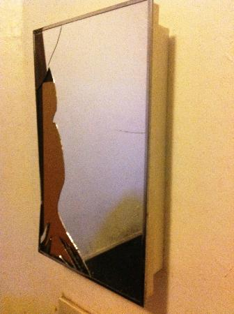 Europa Hotel: vanity mirror in the room...obviously someone punched it or head butted it