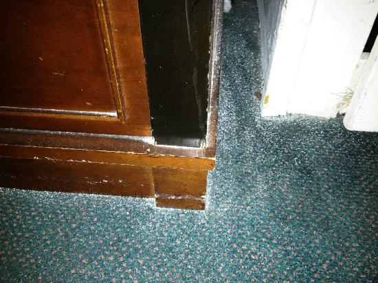 Europa Hotel: What is that? White spots all around the tv stand and closet...couldnt be from painting the plac