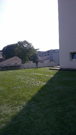 ibis Delemont Delsberg : Interior courtyard - grass is plastic but so real looking