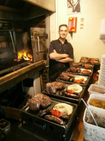 Buen Ayre: Geovane, one of the grill men, with SEVEN! 'parrilladas'