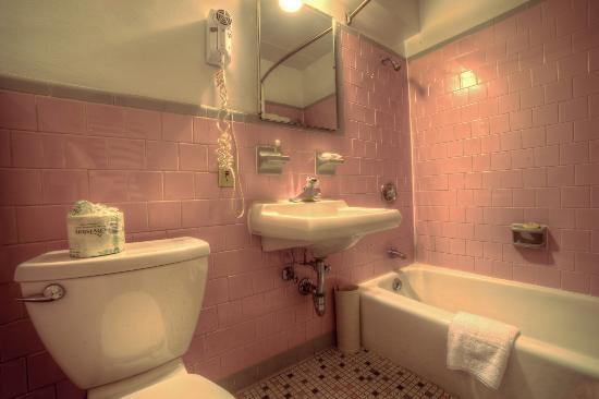 Our classic pink bathrooms fit right in at the retro Americana Hotel Arlington, VA!