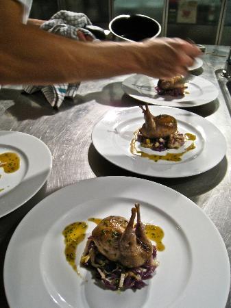 Dar Roumana: Roasted quail farcie, braised red cabbage, jus roti