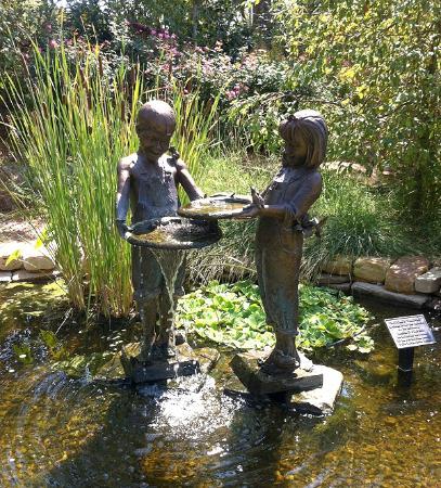 Botanica: The Wichita Gardens: This is a bronze statue found in the Polliwog Pond at the Downing Children's Garden.