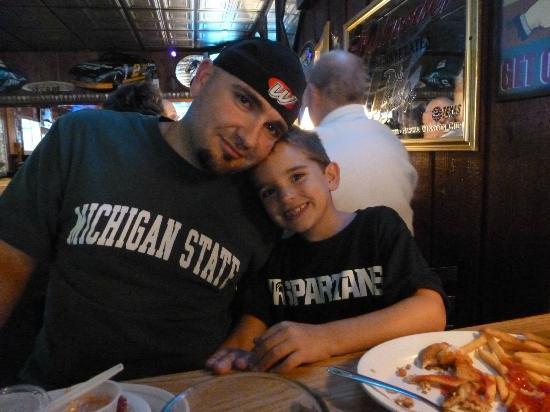 Key Hole Bar: My husband and son eating dinner at The Keyhole Bar