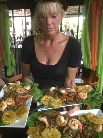 Havana Tropical Cafe: Server holding Day's Specials