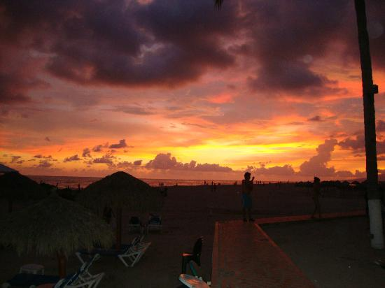 Sunscape Puerto Vallarta Resort & Spa: Sunset view from a beach lounge area of the HI