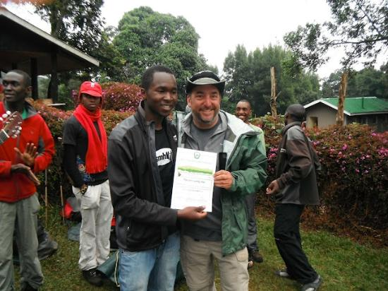 Arusha, Tanzania: Receiving my Kili summit certificate from our guide Emanual