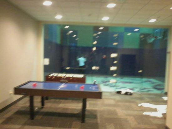 Crowne Plaza Lansing West : air hockey and fooseball tables with basketball area in background