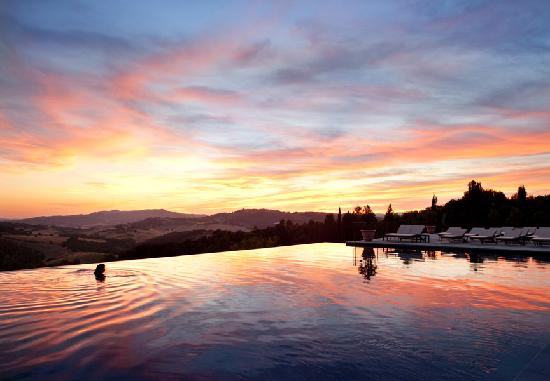 Castello di Casole Private Estate & Spa: infinity pool at the sunset