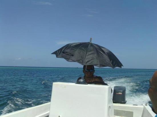 Las Rocas Resort & Dive Center: our captain aboard the dive boat