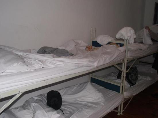 36 Rooms Hostel: uncleaned room on arrival and prison like beds