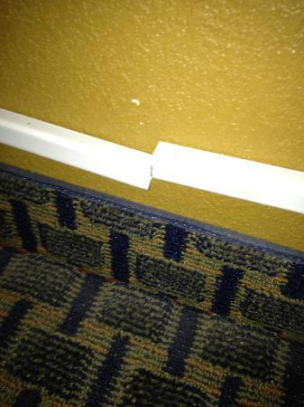 Quality Inn: This is the plastic molding holding the HIGH VOLTAGE! IT'S COMING APART!!!