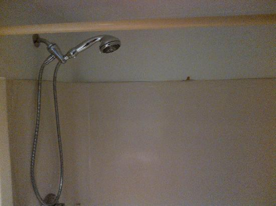 Watermark Inn: Bathroom fixtures consist of deteriorating, yellowed plastic