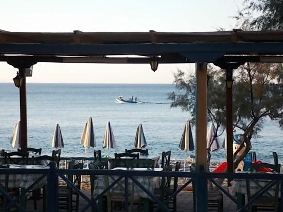 Aphrodite Beach Hotel: Early morning fishing boat passing by the hotel taverna