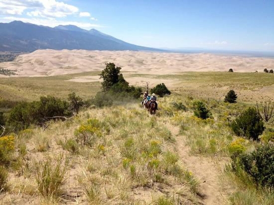Zapata Ranch - A Nature Conservancy Preserve: Riding behind the dunes into the mountains.