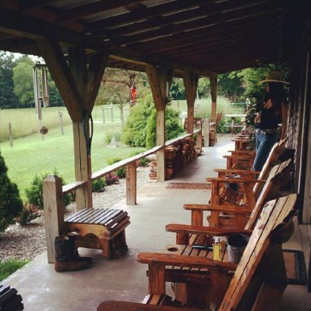 Crazyhorse Ranch & Lodge: We love all the seating on the front porch area. Lots of stories told here.