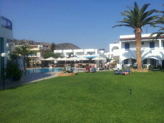Maria Rousse Studios: Grass area towards pool and bar