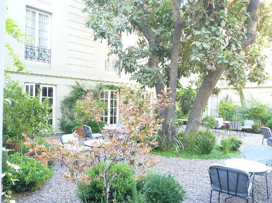 Le Reve Hotel Boutique: Jardin intérieur