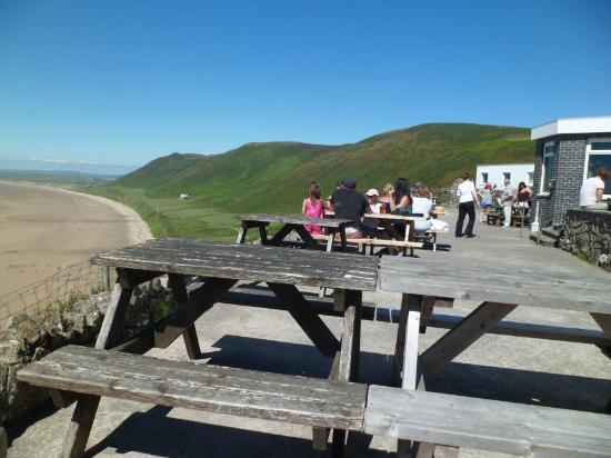 Rhossili Bay: Beer garden of Worms Head Hotel, Rhosili Down in background