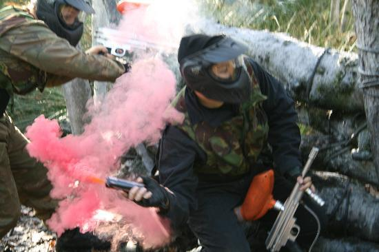 Teamforce Paintball & Activity Centre: Our group throwing a smoke grenade!