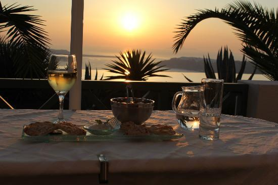 Anastasis Apartments: View of sunset from our terrace along with complimentary drinks every sunset