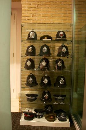 Hotel Ariane: A collection of British Policemens helmets in reception
