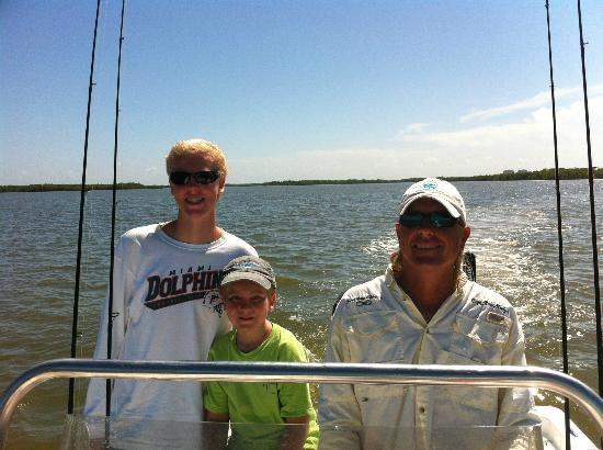 SoulMate Charters: Captain Rob (right) with my sons in Estero Bay.