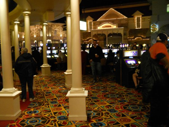 Charles Town, WV: The main floor of the casino shows all the machines being used.