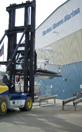 Marina Shores Marina: Forklift launch service included in storage fees.