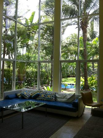 Blue Lagoon Resort Hua Hin: Living area with huge windows looking towards the pool