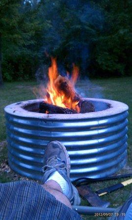 Addison Oaks County Park: Enjoying the camp fire.