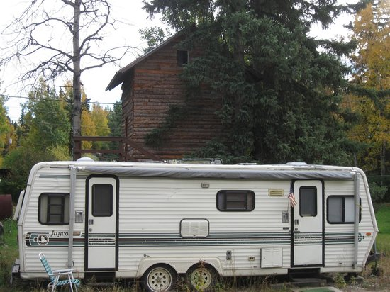 Fairbanks International Hostel: hostel trailer and treehouse (behind trailer)