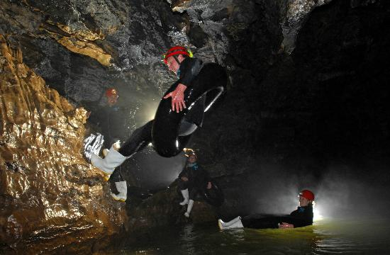 Waitomo Adventures: jumping into the water to start tubing