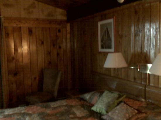 Cove Motel: dark pine walls, depressing paneling visible at the top of the wall on the left.