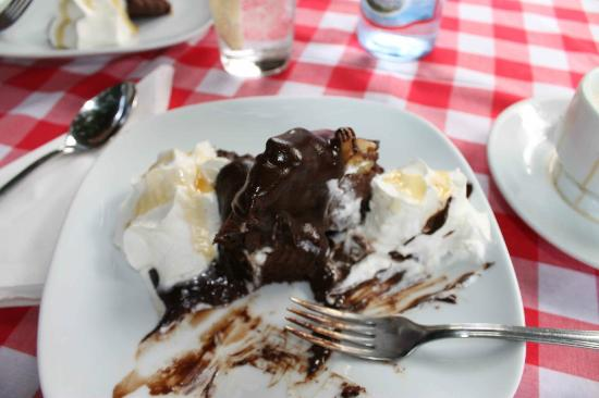 Orient: Chocolate cake with whipped cream and chocolate sauce