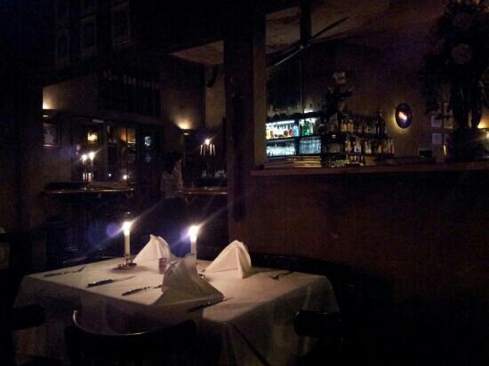 Grand QBA: Lovely candle lit tables.