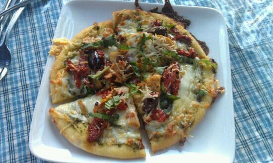Calderas: Mediterranean flat bread with pesto, sundried tomatoes, artichoke hearts, kalamata olives, fresh